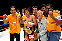 Tomonobu Shimizu (JPN),  Shigeji Kaneko,  Kentaro Kaneko,  Kenji Kaneko, AUGUST 31, 2011 - Boxing : Tomonobu Shimizu of Japan wearing his champion poses with Kaneko boxing gym honorary chairman Shigeji Kaneko (3rd R), president Kentaro Kaneko (4th R) and manager and trainer Kenji Kaneko (L) after winning the WBA super flyweight title bout at Nippon Budokan in Tokyo, Japan. (Photo by Mikio Nakai/AFLO)
