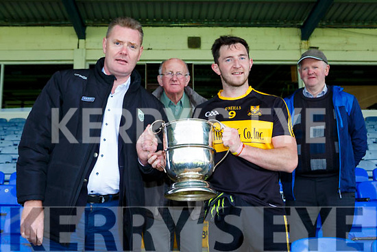 Tim Murphy presents the cup to Daithi Casey captain of Dr Crokes after theydefeated Kenmare in the  County League final in Fitzgerald Stadium on Sunday