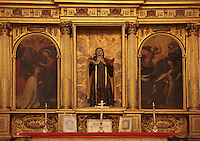 St Teresa with St Peter and St Paul, St Teresa with the Holy Spirit and the Transverberation of St Teresa, from the altarpiece in the Capilla de Santa Teresa da Avila, 17th century, in Granada Cathedral, or the Cathedral of the Incarnation, built 16th and 17th centuries in Renaissance style with Baroque elements, Granada, Andalusia, Southern Spain. Several architects worked on the cathedral, which, unusually, has 5 naves and a circular capilla mayor instead of an apse. Granada was listed as a UNESCO World Heritage Site in 1984. Picture by Manuel Cohen