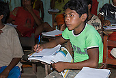 Pará State, Brazil. Aldeia Kokraimoro (Kayapo). Children studying in the village school.