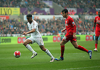 (L-R) Neil Taylor of Swansea City against Pedro Chirivella of Liverpool  during the Barclays Premier League match between Swansea City and Liverpool at the Liberty Stadium, Swansea on Sunday May 1st 2016