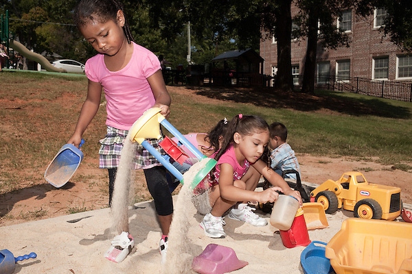 September 14, 2011. Raleigh, NC. . Tatiana Gazga-Santos, left, and Ashely Fuentes-Banegas play in the sandbox during recess.. Project Enlightenment, a public pre-kindergarten program for at risk children, has been threatened with closure due to state wide budget cuts..
