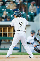 Gorkys Hernandez (9) of the Charlotte Knights at bat against the Gwinnett Braves at BB&T Ballpark on April 16, 2014 in Charlotte, North Carolina.  The Braves defeated the Knights 7-2.  (Brian Westerholt/Four Seam Images)