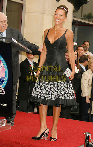 VANESSA L. WILLIAMS.Vanessa L. Williams Celebrates Her Birthday With a Star On The Hollywood Walk of Fame, Holllywood, California, USA..March 19th, 2007 .full length black dress floral print heels clear clutch purse.CAP/ADM/RE.©Russ Elliot/AdMedia/Capital Pictures
