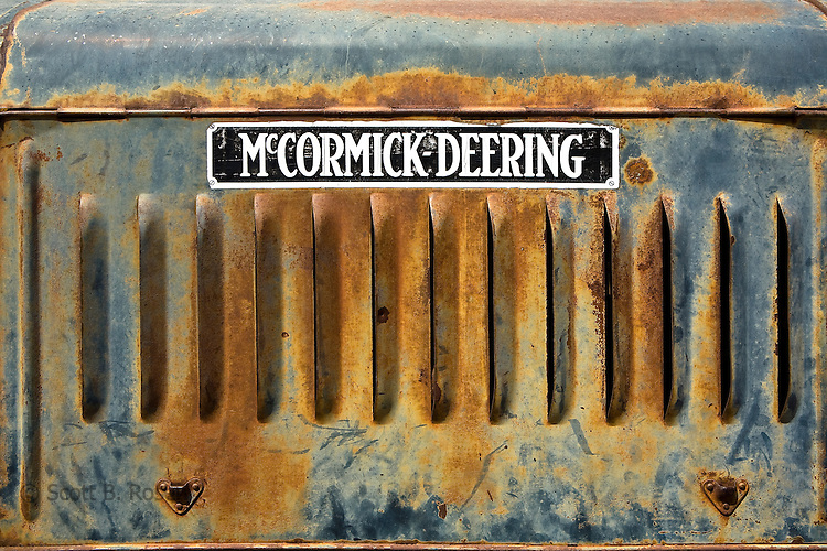 Close-up of details on old, rusted McCormick-Deering tractor