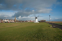 Grass promenade with windmill and old lifeboat house at Lytham, Lancashire,