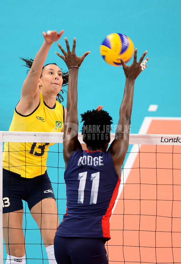 Aug 11, 2012; London , United Kingdom; Brazil player Sheilla Castro (13) spikes the ball against USA player Megan Hodge (11) during the London 2012 Olympic Games at Earls Court. Brazil defeated USA to win the gold medal. Mandatory Credit: Mark J. Rebilas-USA TODAY Sports