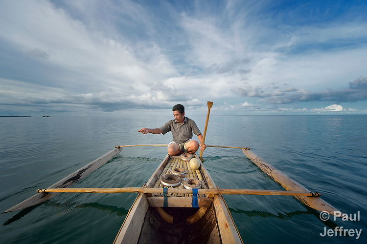 Nurul Huda fishes from his small fishing boat off the Indonesian island of Nias. Huda, a resident of the seaside village of Olora, survived a giant March 2005 earthquake on Nias, yet lost much of his fishing equipment. Church World Service, a member of the ACT Alliance, provided new nets and boats for the fishers of Olora, allowing them to restart their lives. Yet fish have grown scarce in recent years, while fuel prices have risen, making it harder for fishers to earn a living. Huda no longer can afford a motor, and so fishes closer to the island, where the fish are smaller. Climate change has also made it more difficult to predict fish movements, and changing weather patterns can surprise the fishermen at sea. Huda, not surprisingly, wonders if his 16-year old son should pursue another line of work.