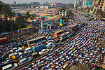 Pictured: Muslims pray in the streets of Tongi, Bangladesh as part of Bishwa Ijteman.<br /> <br /> Millions of praying Muslims stopped traffic today as they took part in an annual religious festival.  They prayed together for ten minutes as traffic came to a standstill in the town of Tongi, Bangladesh.<br /> <br /> The worshippers all faced in one direction, towards Mecca - the holiest of Muslim cities.  SEE OUR COPY FOR DETAILS.<br /> <br /> Please byline: Azim Khan Ronnie/Solent News<br /> <br /> © Azim Khan Ronnie/Solent News & Photo Agency<br /> UK +44 (0) 2380 458800