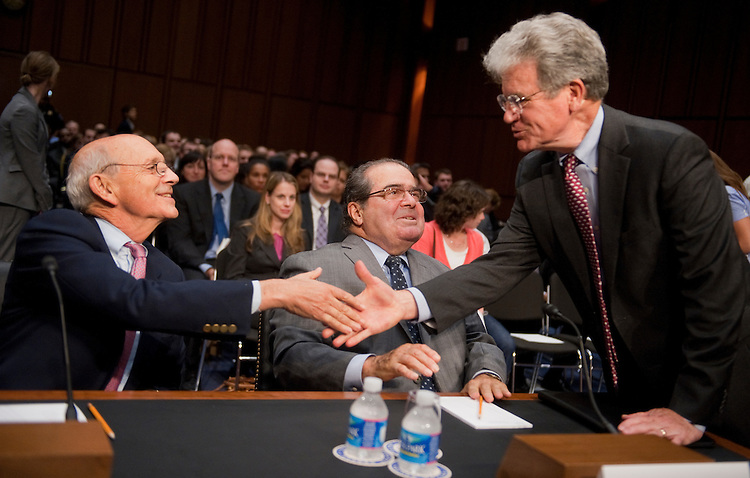 "UNITED STATES - OCTOBER 05:  Sen. Tom Coburn, R-Okla., right greets Supreme Court Justices Stephen Breyer, left, and Antonin Scalia before a Senate Judiciary Committee hearing in Hart Building entitled ""Considering the Role of Judges Under the Constitution of the United States,"" which featured testimony by the justices.  (Photo By Tom Williams/Roll Call)"