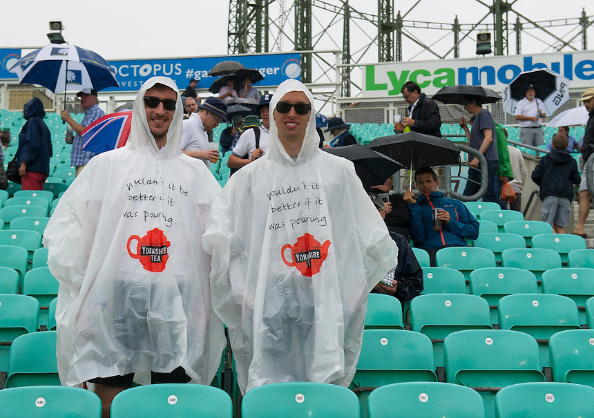 England fans during the rain break on the 4th morning<br /> <br /> Photographer Ashley Western/CameraSport<br /> <br /> International Cricket - Investec Ashes Test Series 2015 - Fifth Test - England v Australia - Day 4 - Sunday 23rd August 2015 - Kennington Oval - London<br /> <br /> &copy; CameraSport - 43 Linden Ave. Countesthorpe. Leicester. England. LE8 5PG - Tel: +44 (0) 116 277 4147 - admin@camerasport.com - www.camerasport.com
