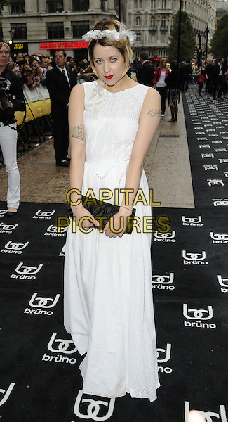 PEACHES GELDOF<br /> UK film premiere of 'Bruno', at Empire Leicester Square, London, England.<br /> June 17th, 2009  <br /> full length white dress tattoos hairband headband black clutch sleeveless long maxi <br /> CAP/CAN<br /> &copy;Can Nguyen/Capital Pictures