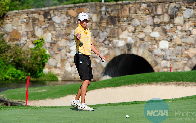 16 MAY 2014:  David Kleckner of Oglethrope University points at the pin during the Division III Men's Golf Championship held at the Grandover Resort in Greensboro, NC.  Kleckner shot a 79 for the final round and 297 overall.  Jeffrey Camarati/NCAA Photos