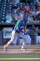 Shortstop Jeison Guzman (7) of the Lexington Legends bats in a game against Columbia Fireflies on Friday, June 14, 2019, at Segra Park in Columbia, South Carolina. Lexington won, 5-1. (Tom Priddy/Four Seam Images)