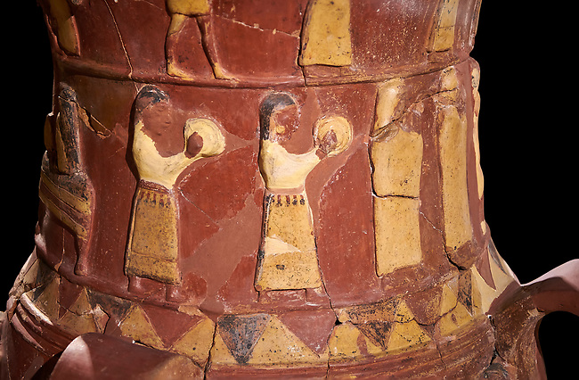 Close up of the Inandik Hittite relief decorated cult libation vase decorated with women relief figures coloured in cream, red and black playing instruments, mid to late 16th century BC - İnandıktepe, Turkey. Against a black background