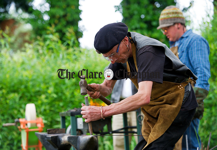 Blacksmith Mark Wilson at work on the anvil as part of the Iniscealtra Festival of Arts at Mountshannon. Photograph by John Kelly.
