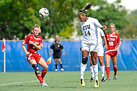26 September 2010:  FIU's Katrina Rose (14) heads in the winning goal in double overtime as the FIU Golden Panthers defeated the Arkansas State Red Wolves, 1-0, at University Park Stadium in Miami, Florida.