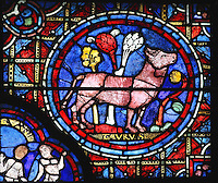 Taurus the bull, standing firm amidst a windy landscape, symbol of power and strength, labour and sacrifice, from the Zodiac and the labours of the months stained glass window, 1217, in the ambulatory of Chartres Cathedral, Eure-et-Loir, France. This calendar window contains scenes showing the zodiacal symbol with its corresponding monthly activity. Chartres cathedral was built 1194-1250 and is a fine example of Gothic architecture. Most of its windows date from 1205-40 although a few earlier 12th century examples are also intact. It was declared a UNESCO World Heritage Site in 1979. Picture by Manuel Cohen