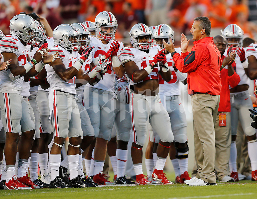 Ohio State Buckeyes head coach Urban Meyer fires up his team prior to the NCAA football game against the Virginia Tech Hokies at Lane Stadium in Blacksburg, Virginia on Sept. 7, 2015. (Adam Cairns / The Columbus Dispatch)