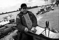 - Delta del Danubio, MIla 23. Un rom che fa lo stagnino ambulante lungo il delta. I Rom che vivono ancora nella zona del delta si occupano ancora dei lavori acquisiti per tradizione famigliare...- Danube Delta Area, Mila 23, A gypsy that work traditionally as tinsmith  along the delta.