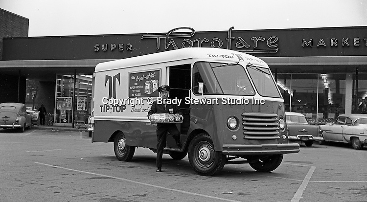 Pittsburgh PA:  Route driver delivering Tip Top Bread to a the Thorofare Super Market - 1958.  On location photography for a local advertising agency - client was Ward Baking Company. Ward Baking used Olson Kurbmasters which were popular parcel delivery vans in the 1960s. They were built using Ford P-series chassis with a slanting engine compartment and slab-sided front end. Kurbmaster is still copied today by many step-van manufacturers.