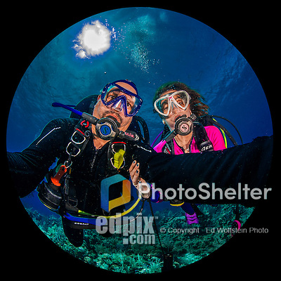 "27 July 2015: SCUBA Divers Sally Herschorn and Ed Wolfstein pose for an underwater ""selfie"" self-portrait at School House Reef, on the North side of Grand Cayman Island. Located in the British West Indies in the Caribbean, the Cayman Islands are renowned for excellent scuba diving, snorkeling, beaches and banking.  Mandatory Credit: Ed Wolfstein Photo *** RAW (NEF) Image File Available ***"