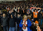 Home fans in the stands at Blackpool FC's Bloomfield Road stadium celebrating at the final whistle against Liverpool FC in a Premier League match. The home side won by two goals to one in front of a crowd of 16,089. It was the first time the clubs had met in a league match since Blackpool were last in the top division of English football in 1970-71.