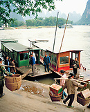 CHINA, Guilin, men working by boat with the Li River in the background