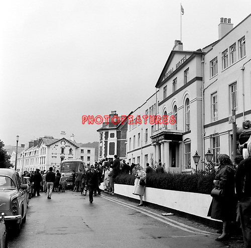 Beatles 1967 Fans and the bus on a grey day at start of Magical Mystery Tour at The Royal Hotel in Teignmouth, Devon 12th September 1967.<br /> &copy; Chris Walter