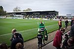Forest Green Rovers 0 Tranmere Rovers 2, 17/10/2015, New Lawn, National League. The home club mascot, known as the Green Devil, pictured with a young fan pitch side at the New Lawn, home to Forest Green Rovers, prior to their match against Tranmere Rovers in the National League. The club is based in the village of Nailsworth in Gloucestershire and is owned by businessmen Dale Vince who doesn't allow meat products to be sold to supporters in the ground. The visitors from Merseyside won this game by 2-0 but the hosts remained top of the division. Photo by Colin McPherson.