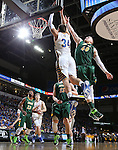 SIOUX FALLS, SD - MARCH 10: Cody Larson #34 from South Dakota State slams home two points past Dexter Werner #40 from North Dakota State in the second half of the Summit League Championship Tournament game Tuesday at the Denny Sanford Premier Center in Sioux Falls, SD. (Photo by Dick Carlson/Inertia)