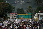 February 15, 2004. Port Au Prince, Haiti. Anti-Aristide march goes out of control with rock throwing and violence. Police used tear gas.