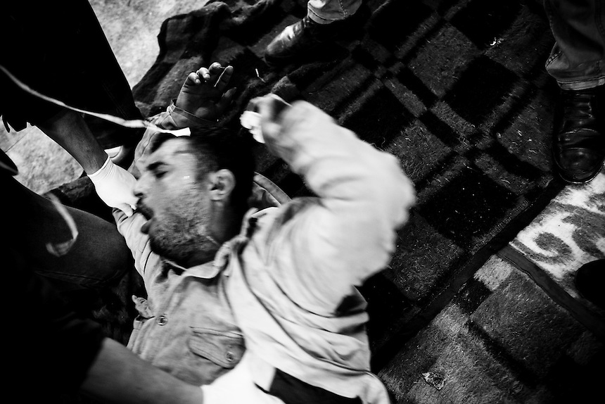 An Egyptian protester wakes up after being knocked unconscious by tear gas exposure during clashes near Cairo's Tahrir Square, November 20, 2011. Photo: Ed Giles.