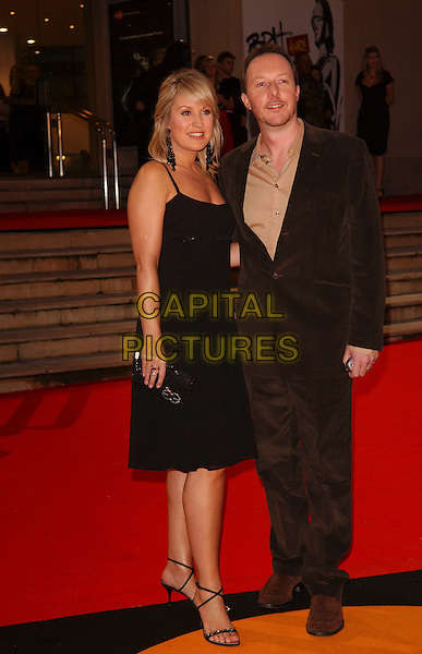 NICKY CHAPMAN & GUEST.The Brit Awards 2006.Earls Court, London England.15 February 2006.Ref: FIN.earl's pop music Brits full length black Nikki .www.capitalpictures.com.sales@capitalpictures.com.© Capital Pictures.