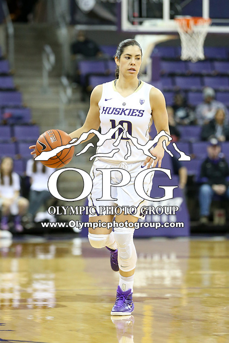 SEATTLE, WA - DECEMBER 18: Washington's #10 Kelsey Plum brings the ball down court against Savannah State.  Washington won 87-36 over Savannah State at Alaska Airlines Arena in Seattle, WA.