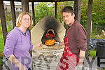 Rachel Budd keeping her homemade Pizza Oven warm before putting her first Pizia into it at the Organic Garden Feste on Saturday at Shanakill/Rahoonane Organic Cente Gardens.........................