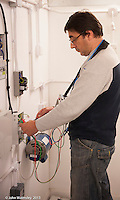 Trainee electrician testing a circuit, Able Skills training centre, Dartford, Kent.