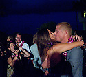 Mick Fanning (AUS) kissing Karissa at the Official Redbull party at Turtle Bay Resort to celebrate a champion on the Northshore of Oahu in Hawaii.