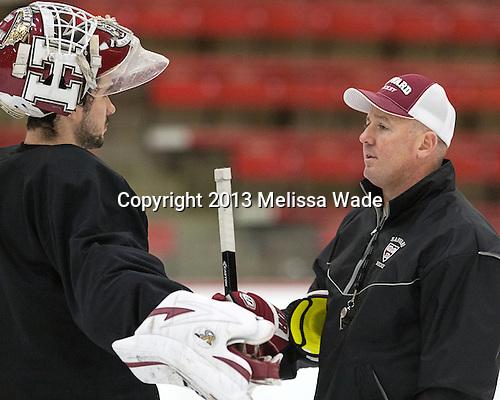Raphael Girard (Harvard - 30), Ted Donato (Harvard - Head Coach) - The Harvard University Crimson practiced on Friday, October 22, 2013, at Bright-Landry Hockey Center in Cambridge, Massachusetts.
