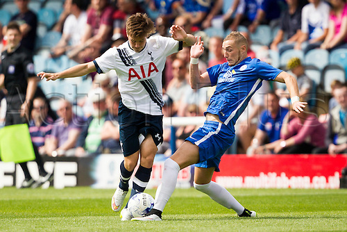 18.07.2015.  Peterborough, Engand. Pre Season Friendly Peterborough United versus Tottenham Hotspur. Kenny McAvoy (Tottenham Hotspur) is tackled by Marcus Maddison (Peterborough United).