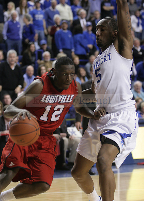 University of Kentucky senior guard Ramon Harris guards University of Louisville guard Reginald Delk during the second half of UK's 71-62 win over Louisville on Sat., Jan., 2, 2010 at Rupp Arena in Lexington, Ky. With this win, UK's record improves to 15-0...Photo by Ed Matthews | Staff