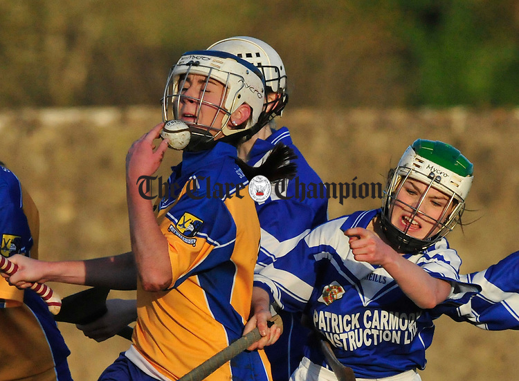 Sixmilebridge's Aiveen O' Shea under pressure from Kilmaley's Ashling Darcy. Photograph by Declan Monaghan