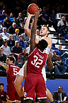 BROOKINGS, SD - JANUARY 13: Mike Daum #24 from South Dakota State University takes the ball to the basket over Abiola Akintola #32 from Denver during their game Saturday afternoon at Frost Arena in Brookings, SD.  (Photo by Dave Eggen/Inertia)