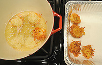 NWA Media/Michael Woods --12/14/2014-- w @NWAMICHAELW... Latkes (a potato pancake) are cooked Sunday afternoon during the annual Hanukkah party at Temple Shalom in Fayetteville as temple members prepare for their afternoon party.  Hanukkah officially begins on Tuesday at sundown.