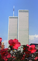 The twin towers of the World Trade Center risa above a flower bed in  New York City in the pre-9-11 days of summer 1999.  (Photo by Brian Cleary/www.bcpix.com)