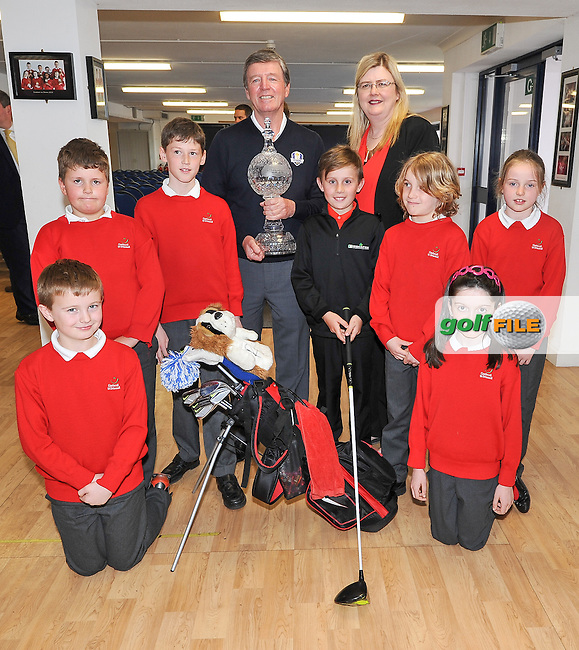 11.05.2016<br /> Golfer Des Smyth with Sean Reddy and some of his class-mates, during the visit of the Dubai Duty Free Irish Open Golf trophy to Gaelscoil Ui Drisceoil in Glanmire, Co Cork. Also included is principal Siobhan Ni Chathain.<br /> Picture: Golffile | David Keane<br /> <br /> All photo usage must carry mandatory copyright credit (&copy; Golffile | David Keane)