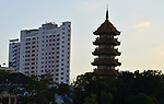 The Chinese style Chee Chin Khor pagoda alongside modern architecture at the Chao Praya river side in Thonburi,Bangkok,Thailand