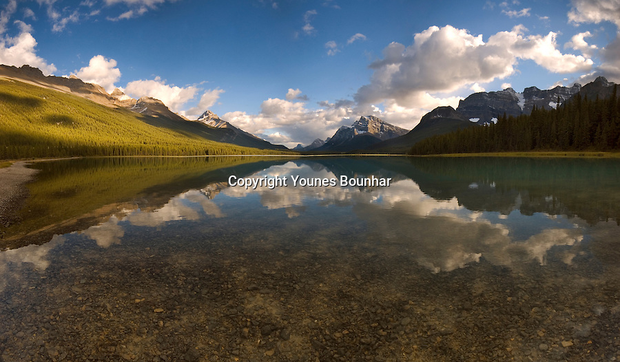 Waterfowl lake reflecting mountains in the late afternoon light, including mount Howse and Mount Cephren - Panorama