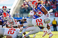 January 02, 2012:    Ohio State Buckeyes defensive back Bradley Roby (25) makes a flying  tackle during first half action at the 2012 Taxslayer.com Gator Bowl between the Florida Gators and the Ohio State Buckeyes at EverBank Field in Jacksonville, Florida.