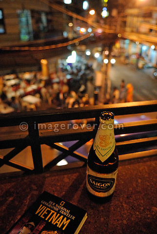 "Asia, Vietnam, Ho Chi Minh City (Saigon). Drinking a bottle of Saigon beer ""Bia Saigon"" in the backpackers area around Pham Ngu Lao / Bui Vien St. --- No releases available."